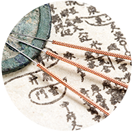 Acupuncture needles on cloth with Chinese characters - Naturopathic Medicine tools