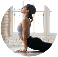 Woman doing yoga poses - naturopathic medicine