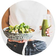 Hands holding salad and smoothie - naturopathic medicine through weight management